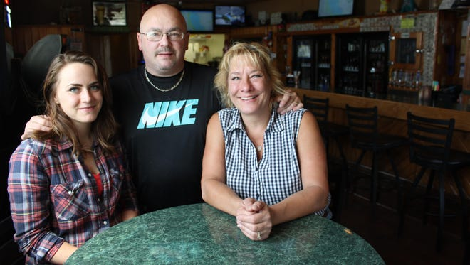 From left: Cally Gordon, Rick Gordon and Maggie Gordon stand in the recently renovated and newly opened M & R Station. The establishment was formerly home to Sidetracked, a bar that was the site of a fatal 2014 shooting. The new owners are hoping to turn its reputation around and transform it into a family friendly place.
