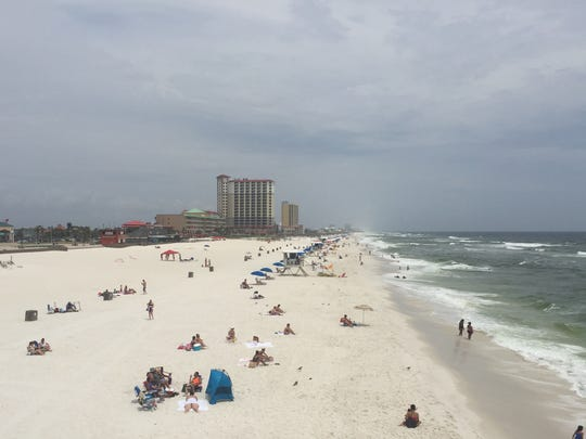 Vacationers relax on Pensacola Beach on Monday afternoon.