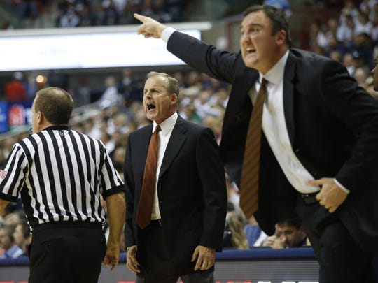 Chris Ogden, right, began his coaching career at Texas with Rick Barnes.