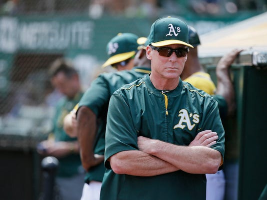 """FILE - In this Sept. 2, 2015, file photo, Oakland Athletics manager Bob Melvin walks in the dugout during the team's baseball game against the Los Angeles Angels in Oakland, Calif. Baseball is full of superstitions. Melvin might just be known among baseball's most superstitious, according to his former catcher Stephen Vogt, who claims """"Melvin's one of the most superstitious people I've ever met, down to which undershirt he's wearing, what he wore to the game before, who takes the lineup card out."""" (AP Photo/Eric Risberg, file)"""