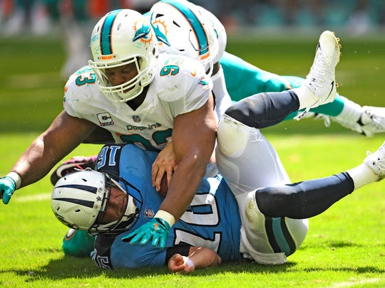 Titans quarterback Matt Cassel (16) is sacked by Dolphins