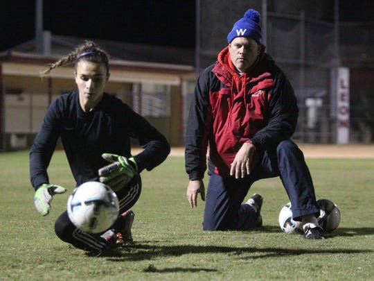 Leon assistant girls soccer coach Lance Kerwin works with his goalkeepers prior to a game.