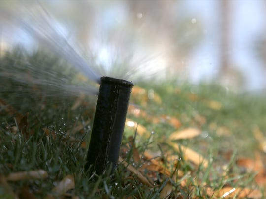 A sprinkler soaks a lawn in Palm Springs. The city — which among Desert Water Agency's largest customers — says it reduced its water use by nearly 500,000 gallons in the past six months.