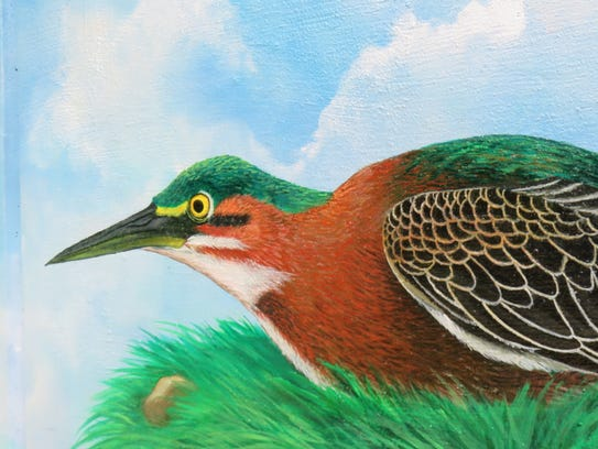 A green heron on the mural.