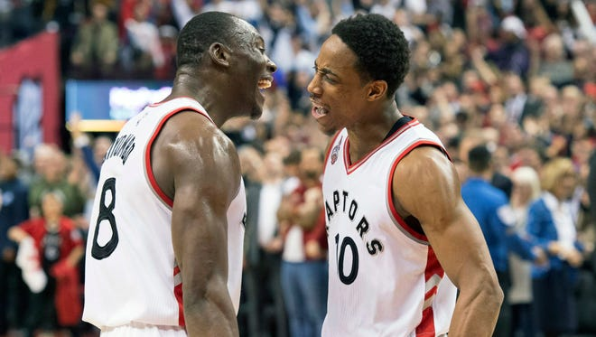 Toronto Raptors guard DeMar DeRozan (10) celebrates his team's victory over the Indiana Pacers with teammate Bismack Biyombo.