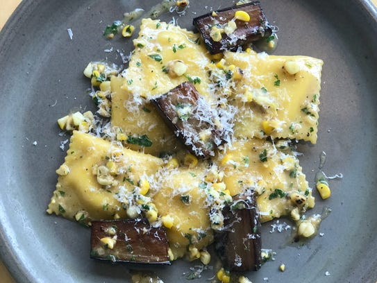 Corn ravioli with eggplant and truffle butter by chef