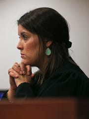 Judge Amber Wolf listens during the hearing of triple