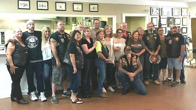 The Moose Lodge group, the Moose Riders, recently conducted a spaghetti dinner fundraiser for Serenity Inc. The group sold over 80 dinners, which along with donations from individuals and the club, produced a $1,000 check. Serenity is an organization whichassists victims of domestic violence, along with theirchildren and pets. They also provided items for our clients and the shelter. Participating in the fundraiser were:Moose Riders Officers,David Albrecht, President; Kathy Davidson, Vice-President; Sherry Powell,Secretary (not pictured);Brian Andrus,Treasurer; Tim Baughman,Road Captain; Frank Stevens, Sergeantat Arms; Anos Arkangel,Chaplain (not pictured);Richie Yanke, past President, (not pictured); and members,Amy Cooper;David Albrecht Jr;Sabrina Albrecht;Regeana Baughman;Vita Stevens;Jesse;Sunshine Workman;Thaddeus Workman;Debbie Wilhite;David Leatherbarrow;Arlene Andrus;Rex Wilhite;Donna Hamby andJerry Kimble.