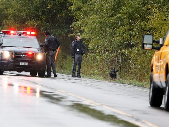 New York State Police search the woods near Kneale
