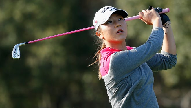 Lydia Ko of New Zealand watches her tee shot on the 15th hole at the Coates Golf Championship.