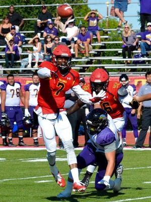 Ferris State quarterback Reggie Bell passes during a game against Ashland at Top Taggart Field in 2016. Bell has been dealing with an ankle injury and his status for Saturday's game against Grand Valley State is unclear.