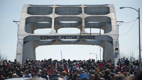 People gather on the Edmund Pettus Bridge in Selma,