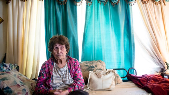 Eva Stephens, 88, sits in her house in Montgomery,