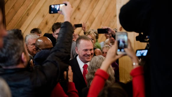 Roy Moore, Republican Senate nominee, is greeted as