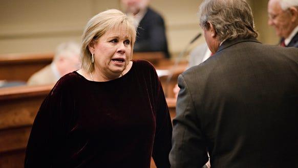 Harri Anne Smith, I-Slocomb, talks to another senator during the Alabama Legislative session on Thursday, Feb. 15, 2018, in Montgomery, Ala.