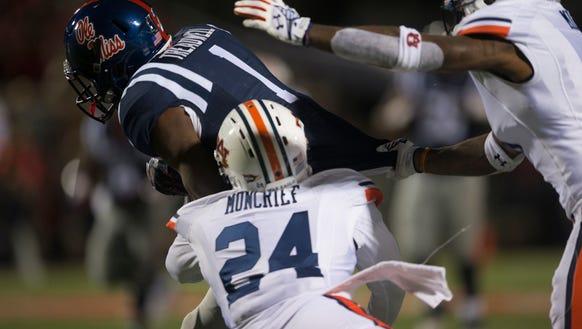 Auburn defensive back Derrick Moncrief (24) and Auburn