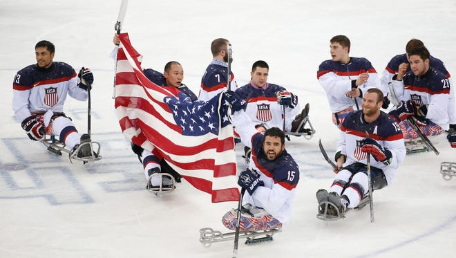United States players celebrate as they win the gold medal after their ice sledge hockey match against Russia at the 2014 Winter Paralympics in Sochi, Russia, Saturday.