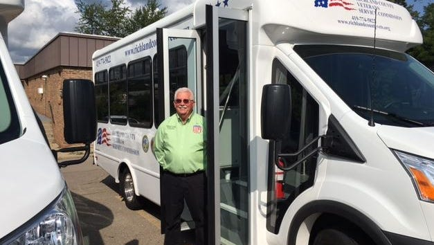 Ken Estep, director of the Richland County Veteran Services Commisison, stands next to one of two new vans which will begin Monday transporting local veterans to their medical appointments in Cleveland.