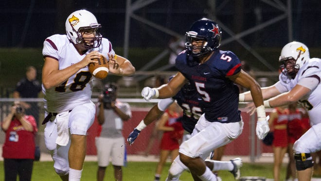 Pearl River quarterback Andrew Dunn scrambles to buy extra time with a defender in pursuit during last week's game against Northwest at Senatobia.