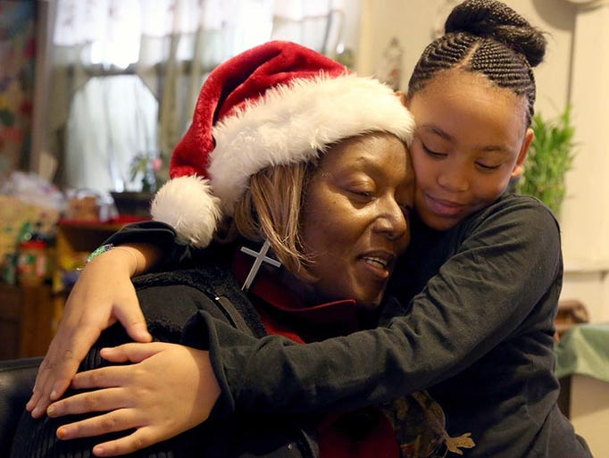Diane Bailey gets a hug from her granddaughter Akeyea