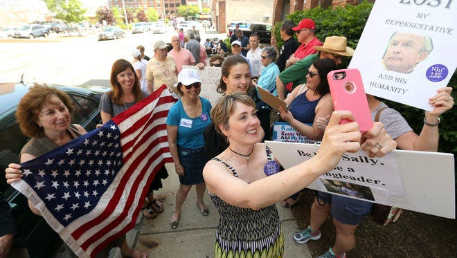Sarah Foye of Pinebrook, NJ talks a selfie with other members of the grassroots group 'NJ 11th for Change' as they rally at the Morristown office of Congressman Rodney Frelinghuysen. The protests at the congressman's office  have been taking place since December 2016, nicknamed Friday's with Frelinghuysen. The GOP lawmaker is facing an ethics complaint after targeting a local liberal activist through a fundraising letter to her employer. May 19, 2017, Morristown, NJ.