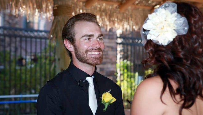 Sean Misner with his wife, Amanda, on their wedding day. He died with 18 of his crewmen less than 10 months later in Arizona's Yarnell Hill Fire.