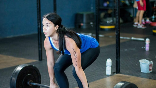 Mild-mannered reporter by day, mediocre CrossFit athlete by night — our own Annabelle Tometich is among 500-some athletes competing at this weekend's Thunderdome competition at Germain Arena.
