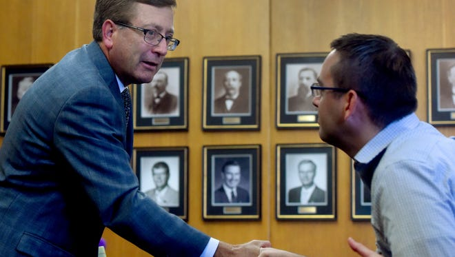 Sioux Falls mayor Mike Huether shakes hands with Sioux Falls City Councilor Greg Neitzert after a press conference announcing his decision to veto the City Administration building Ordinance repeal.