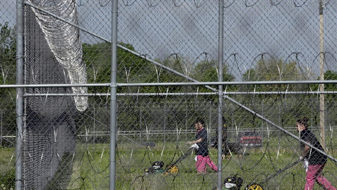 Female inmates mow grass at the Milwaukee County House of Correction in Franklin, in 2013