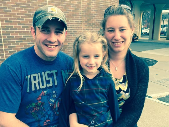 Mike and Amy Collins of Southport are shown with daughter