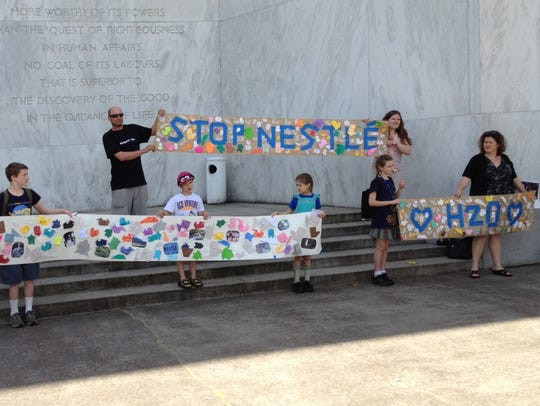 A group protests a proposed water-bottling plant in