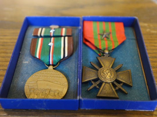 Cindy and John Thompson, of Northville, Mich., found two medals that once belonged to William H. Billman, of Zanesville. The honors were recently returned to Billman's relatives, who live in Zanesville.