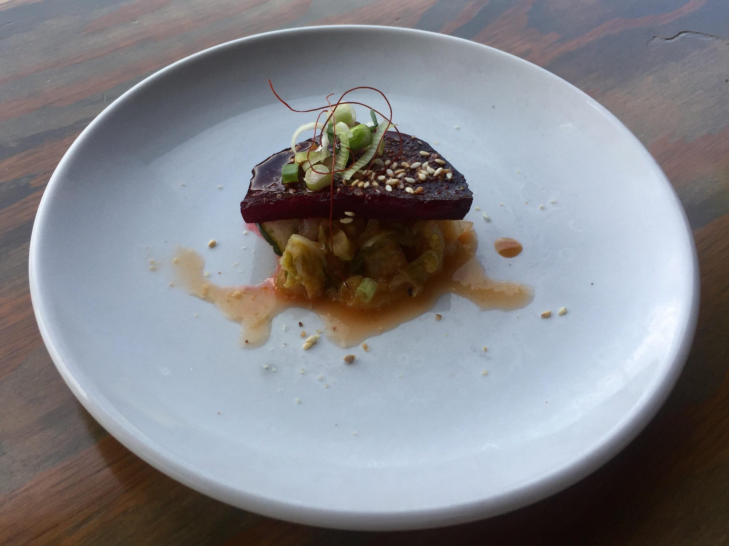 A tasting portion of roasted beets with cucumber kimchi