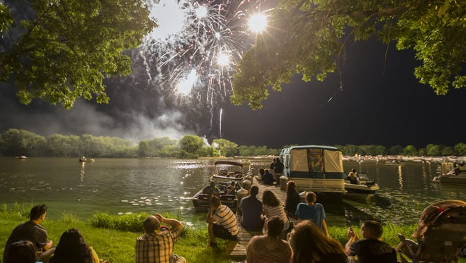 People watch the Festival Foods Fourth of July fireworks display at Sawdust Days in Menominee Park in this file photo.