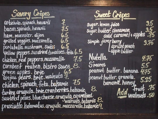 The sweet and savory crepes are listed on a chalkboard at Perch.