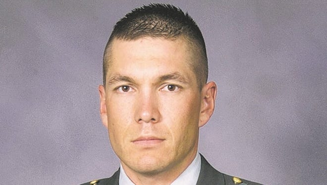 This is an undated photo provided by the Carson City Sheriff's Office, of Sgt. 1st Class Christian Riege. Riege, 38, of Carson City, Nev., was one of three National Guard members killed by a gunman during a shooting rampage at an IHOP restaurant in Carson City, Nev., on Tuesday, Sept. 6, 2011. (AP Photo/Carson City Sheriff's Office)