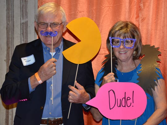 Don and Karen Fisher have fun at the photo booth at
