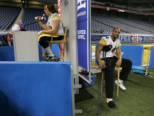 Alan Faneca, left, answers questions while injured teammate Andre Frazier sits on the sidelines, as the Steelers gather for media day at Ford Field on Jan. 31, 2006 at Super Bowl XL in Detroit.
