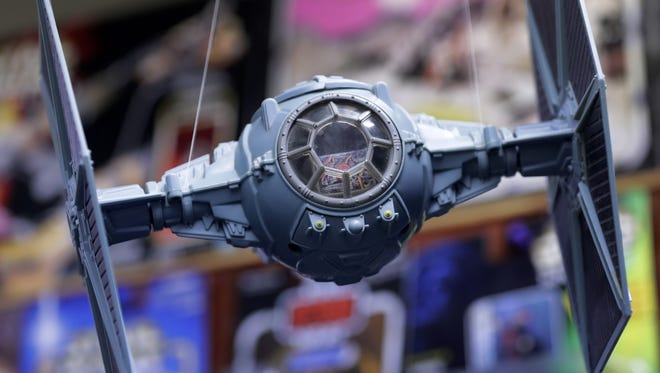 """A """"Star Wars"""" tie fighter hangs on display at Replay Toys in Appleton."""
