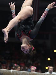 The Southern Utah University gymnastics team compete