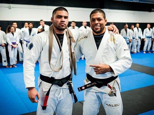 Professor Andre Galvao after promoting Mike Carbullido of black belt in jiu-jitsu.
