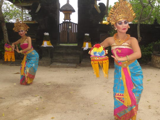 A traditional Balinese dance performance in the courtyard