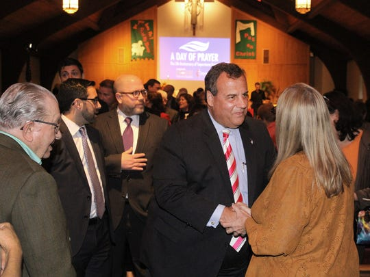 NJ Gov. Chris Christie greets people after a 'Day of