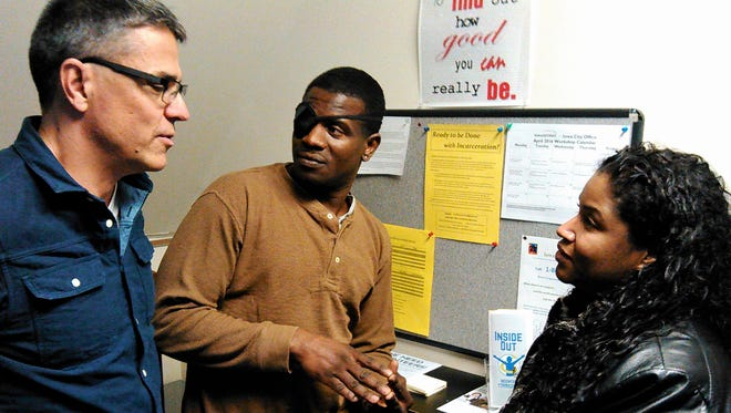 Mike Cervantes, left, talks with Inside Out participant Robert Crader and mentor Alicia Velez at the new organization's office above First Baptist Church in Iowa City. Cervantes was hired on a part-time basis to be the group's first director.
