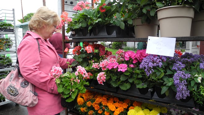 A woman samples the goods during the 2013 Festival of Flowers in Jefferson. The annual event is a fundraiser for Friends of the Jefferson Library.