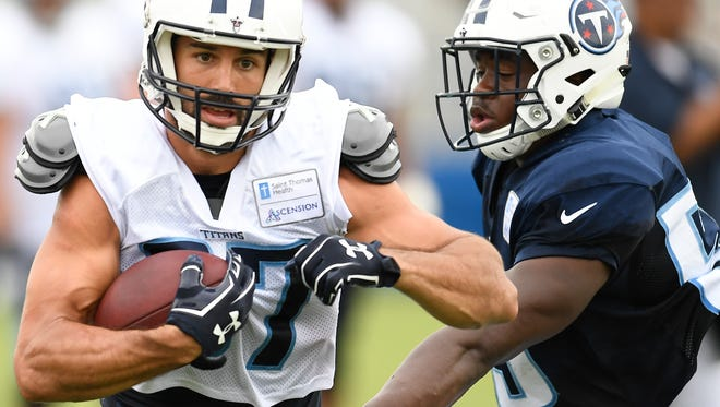 Titans wide receiver Eric Decker (87) speeds past linebacker Jayon Brown (55) during training camp practice at Saint Thomas Sports Park Tuesday, Aug. 1, 2017 in Nashville, Tenn.