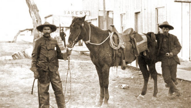 """These Hashknife Cowboys, pictured in Holbrook circa 1900, are part of the early association of the Hashknife brand, when the infamous """"Hashknife outfit"""" was known for its 60,000 head of cattle and """"the unsavory reputation of having 'the thievinist, fightinest' bunch of cowboys in the United States,"""" as once reported by Frazier Hunt. In 1955, the brand was adopted by the Navajo County Hashknife Sheriff's Posse, which was organized primarily as a search and rescue organization, but has become known for its annual run from Holbrook to Scottsdale known as the Hashknife Pony Express Ride."""