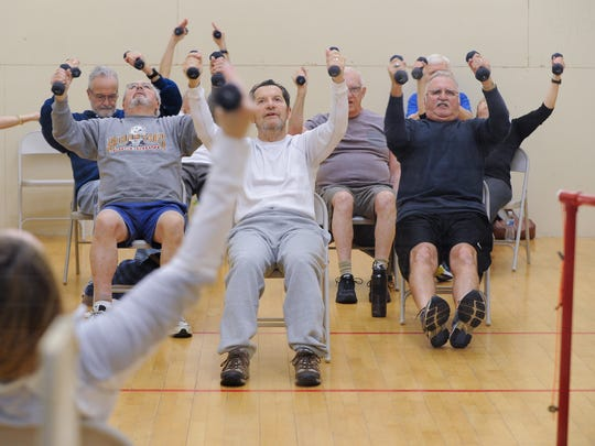 David Kobrin, center, of Lewes participates in the Parkinson's exercise class at Midway Fitness in Rehoboth Beach.