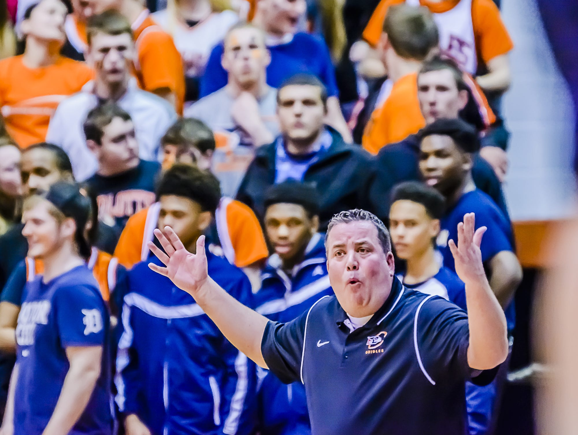 Charlotte boys basketball coach Steve Ernst questions a no-call under the Charlotte basket during the Orioles' Class B regional semifinal game with Haslett in March of last year in Charlotte. Ernst resigned Monday after officials put him on a second individual development plan because he has six technical fouls in his last 30 games.