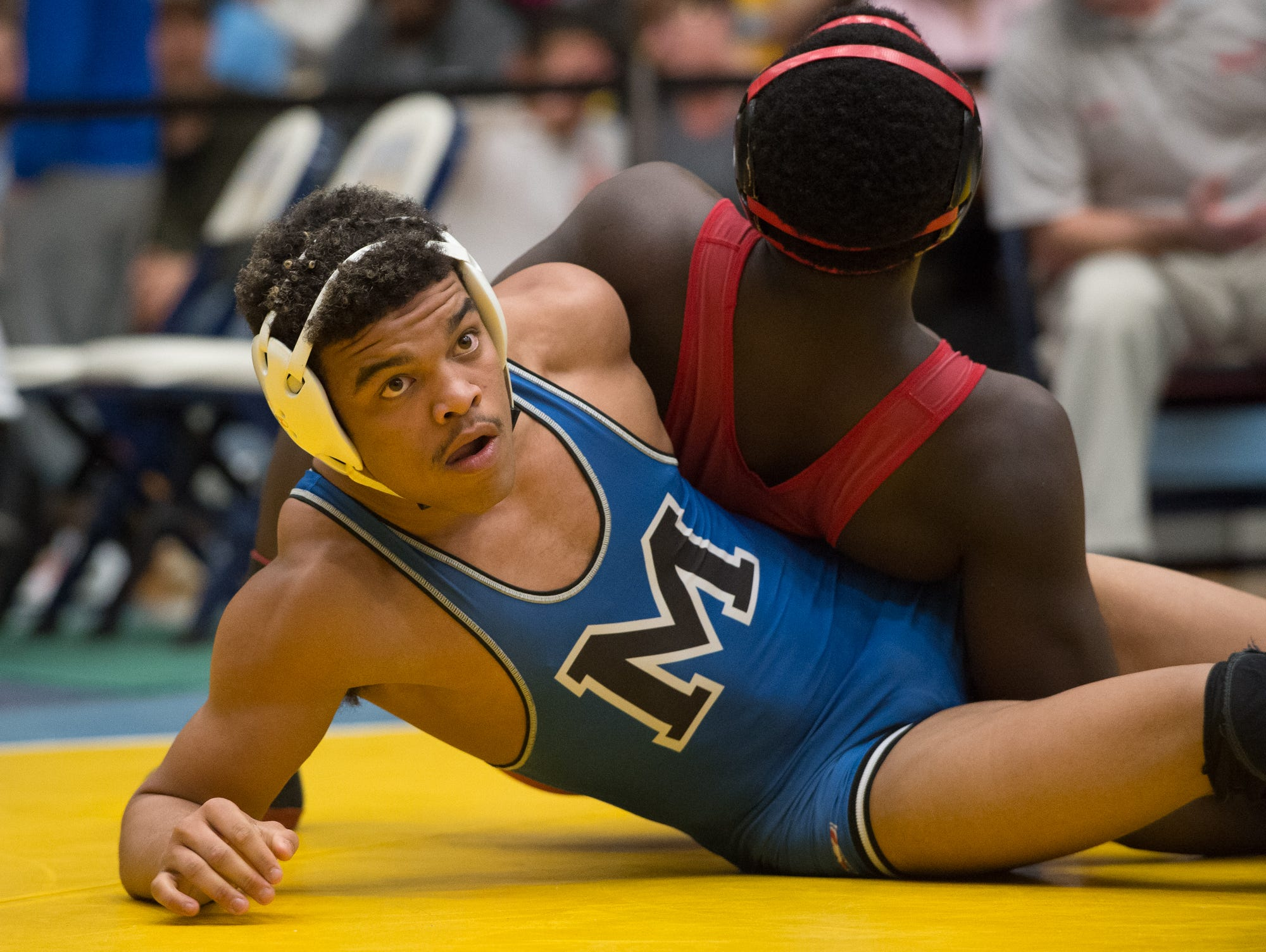 Middletown's Isiah Mitchell wrestles Smyrna's Larsen Wilson in the 170 pound quarterfinals at the DIAA Individual State Tournament at Cape Henlopen High School.